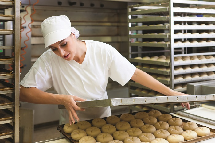 Image-of-female-baker-with-bread-rolls