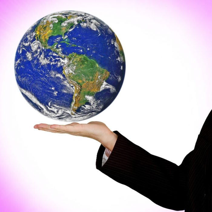 Image-of-hand-holding-globe-of-earth