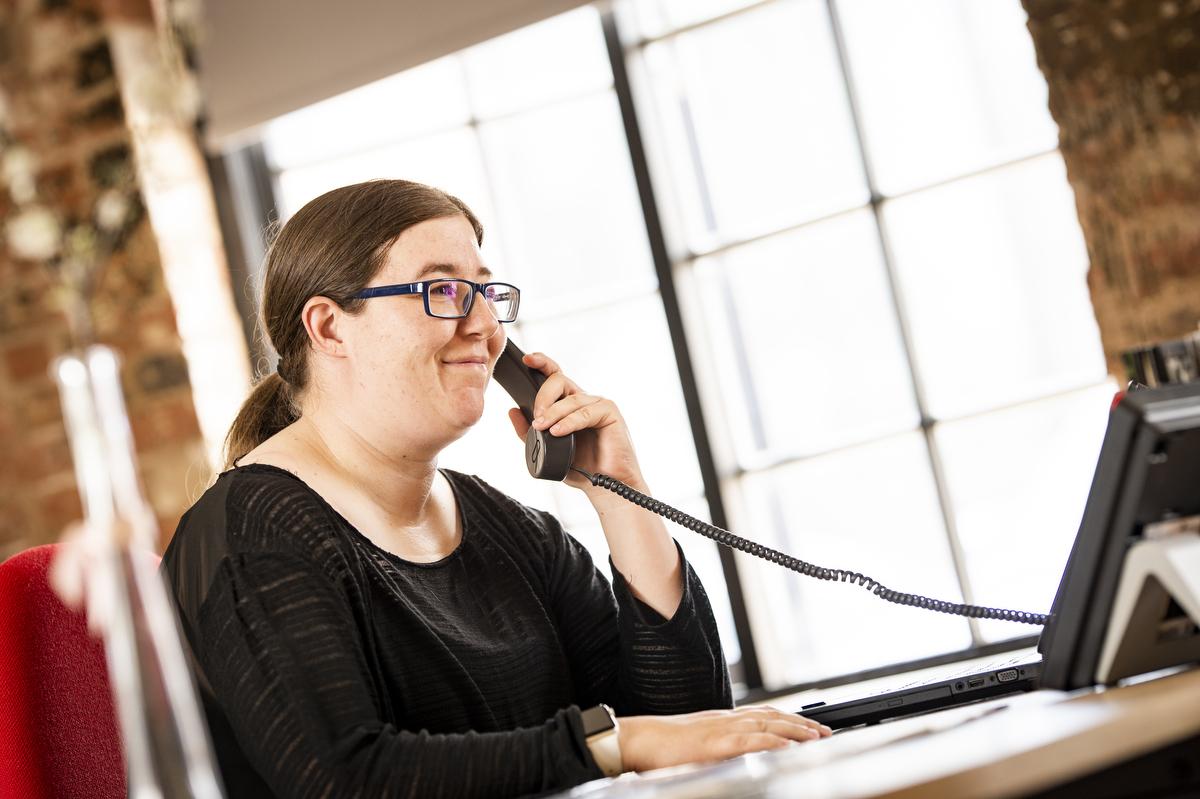 Lady speaking on telephone