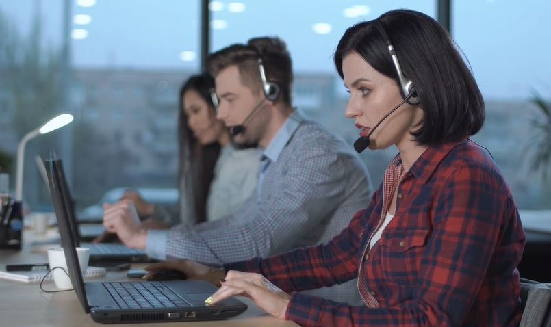 Call centre staff with headsets