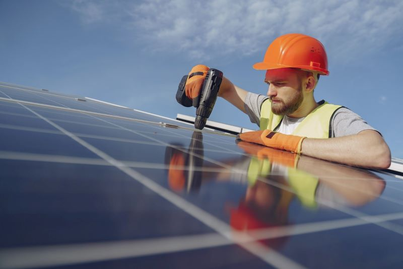 Worker-fitting-solar-panel
