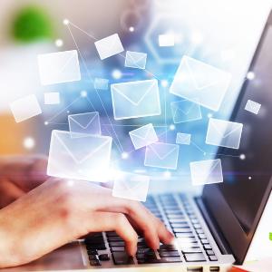 keyboard-hands-floating-envelopes