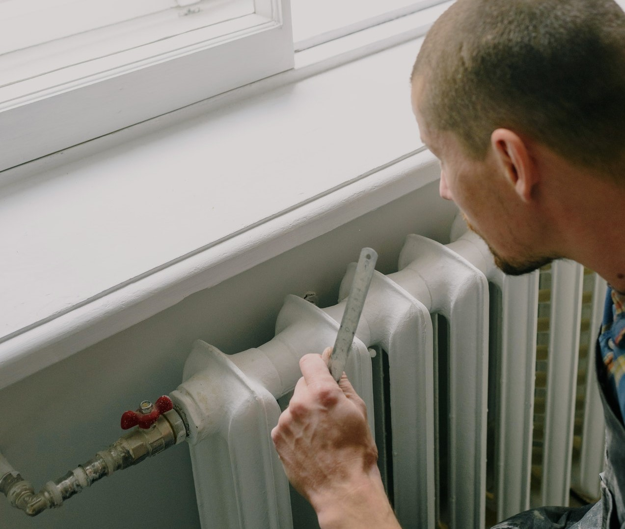 tradesman-at-radiator