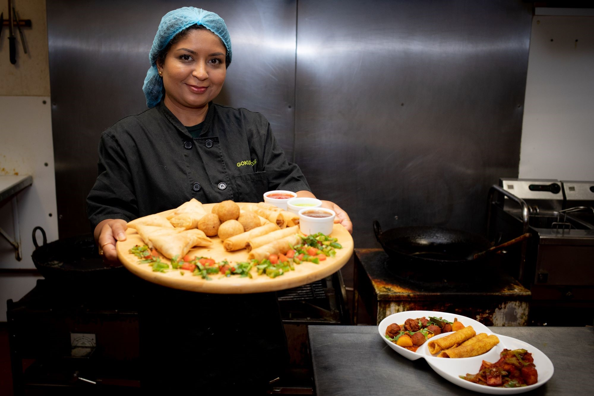 Lady holding a range of indian food