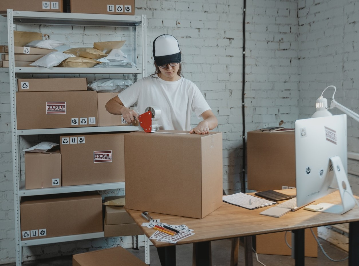 female-taping-up-boxes