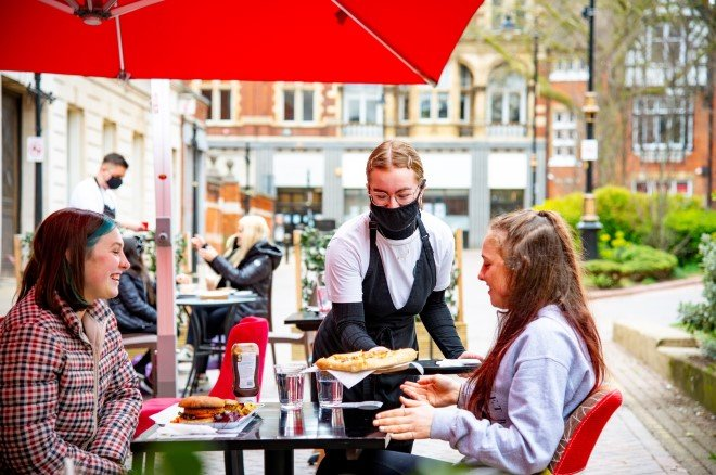 people being served at an outdoor cafe