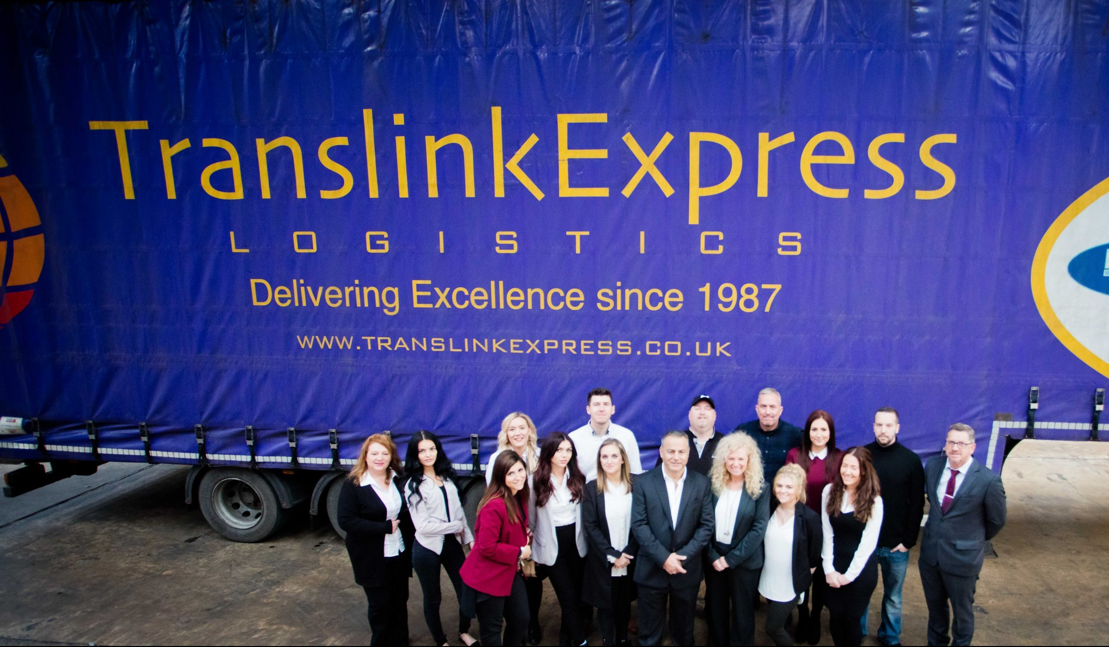 Truck-and-people-in-front-translink-team