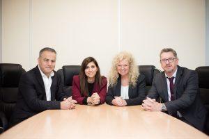 Four-people-at-desk-translink-directors