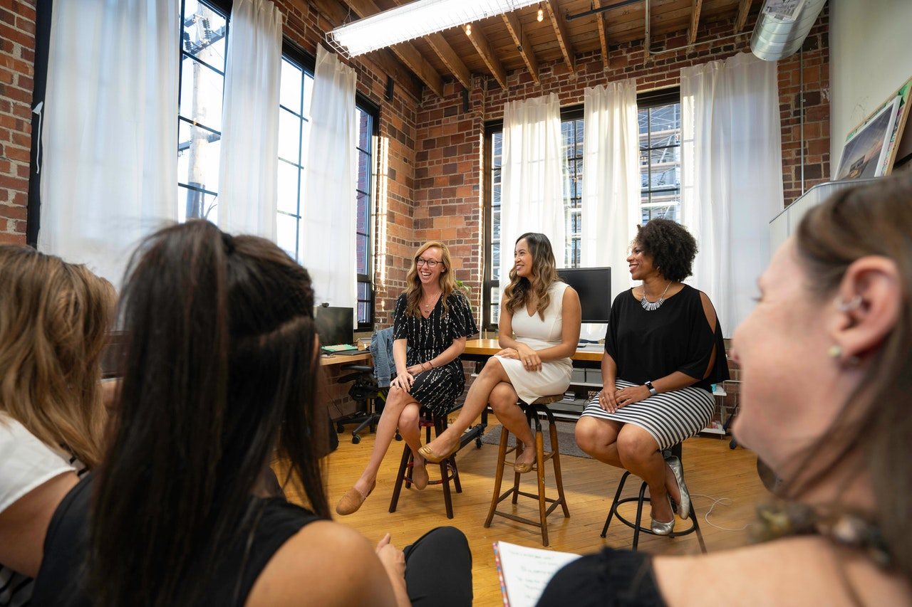 three-females-pitching-to-an-audience