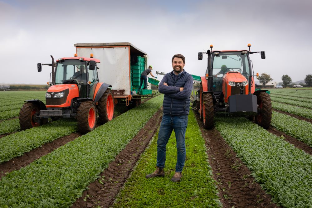 Adam-Lockwood-in-field-with-two-tractors-behind