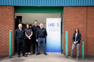 Five-people-outside-industrial-unit-UKBITS